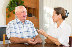Serious couple talking in home interior Royalty Free Stock Photo
