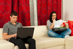 Serious couple working home Stock Photography