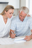 Serious couple working out their finances Stock Images