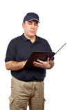 Serious courier writing Royalty Free Stock Image