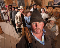 Serious Cowboy with Rifle in Saloon Royalty Free Stock Photo