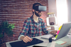 Serious creative businessman using 3D video glasses and laptop Stock Photo