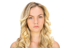 Serious curly haired blonde posing Stock Images
