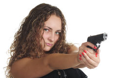 Serious curly woman with gun Stock Images