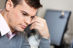 Serious Customer Service Representative In Office Royalty Free Stock Photo