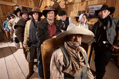 Serious Customers in Old Western Bar. Serious customers in classic old American west saloon Royalty Free Stock Photos