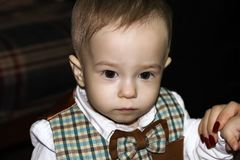 Serious cute baby is looking away. Portrait royalty free stock images