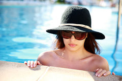 Serious cute girl in swimming pool Royalty Free Stock Image
