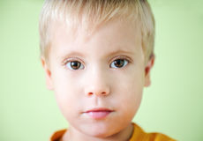 Serious cute little boy Stock Photography