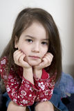 Serious cute little girl five years old. Portrait of serious cute little girl five years old Royalty Free Stock Images
