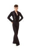 Serious dancer in black suit Stock Images