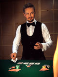 Serious dealer puts the last card on the table Stock Photo