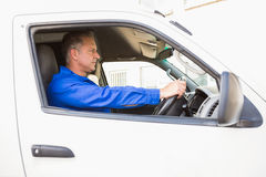 Serious delivery man driving his van Royalty Free Stock Photos
