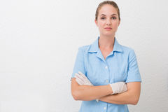 Serious dental assistant looking at camera Royalty Free Stock Images