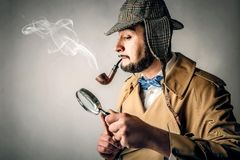 A serious detective. The portrait of a detective looking like Sherlock Holmes stock images