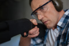 Serious determined man putting the trigger Stock Images