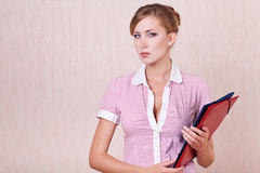 Serious and difficult businesswoman in work Stock Image