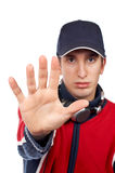 Serious disc jockey saying stop. Over a white background. Hand in focus royalty free stock image
