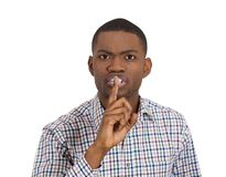 Serious displeased man with finger on lips Royalty Free Stock Image