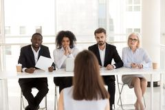 Serious diverse hr group listening applicant performance at job royalty free stock photography