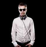 Serious dj with headphones Stock Photo