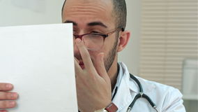 Serious doctor checking important medical analysis stock footage