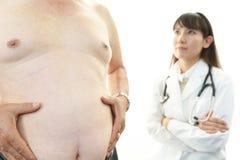 Serious doctor examining a patient obesity Stock Photos