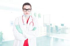 Serious doctor with folded arms Stock Photo
