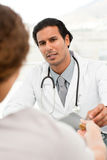 Serious doctor giving pills to his patient Royalty Free Stock Photography