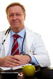 Serious doctor in his office Stock Image