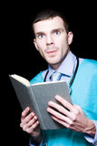 Serious Doctor Holding Medical Research Book Royalty Free Stock Photo