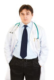 Serious doctor keeping his hands in pockets Royalty Free Stock Image