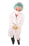 Serious doctor with pills royalty free stock photography