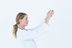 Serious doctor preparing syringe Stock Images