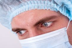 Serious doctor's glance. Close up of doctor looking seriously at something Royalty Free Stock Photo