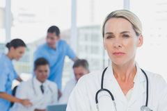 Serious doctor standing Royalty Free Stock Photography