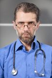Serious doctor with a stethoscope Royalty Free Stock Image