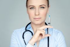 Serious doctor with syringe royalty free stock image