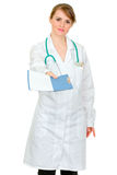 Serious doctor woman giving medical chart Stock Image