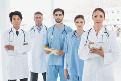 Serious doctors all standing together Royalty Free Stock Photography