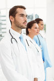 Serious doctors at medical office Stock Image