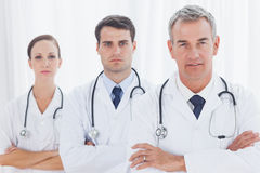 Serious doctors posing together Royalty Free Stock Photography