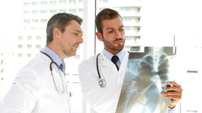 Serious doctors studying an xray. At the hospital stock footage