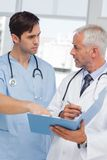 Serious doctors talking about file Stock Photo