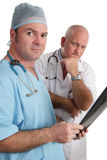 Serious Doctors With Xrays Stock Photos