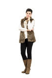 Serious doubtful woman in warm clothes looking at camera. Stock Photo