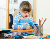 Serious drawing on paper in home Stock Images