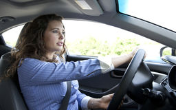 Serious Driver. Woman driving a car on the highway Royalty Free Stock Photo