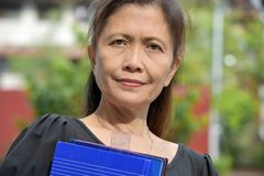 Serious Educated Person With Notebooks. An attractive and asian person stock photos