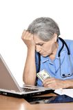 Serious elderly doctor Stock Images
